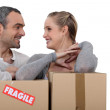 Couple stood with cardboard boxes — Stock Photo #14715337
