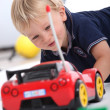 Stock Photo: Little boy with radio controlled car