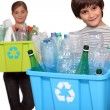 Children recycling plastic bottles — Stock Photo #14716245