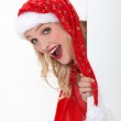Young woman dressed as a Santa Claus — Stock Photo
