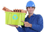 A manual worker promoting recycling. — Stock Photo