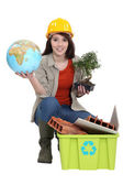 Craftswoman posing with recycling tub and globe — Stock Photo