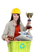 Female builder holding award for recycling — Stock Photo