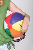 Faceless blonde holding a beach ball — Stock Photo