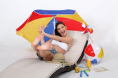 Girl jumping on hammock with beach accessories — Stok fotoğraf