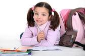 Little schoolgirl with backpack — Stock Photo
