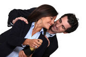 Couple with bottle of champagne — Stock Photo