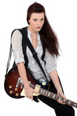 Female guitarist — Stockfoto