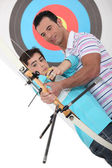Father and son practising archery — Stok fotoğraf