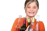 Little girl with empty bottles — Stock Photo