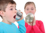 Kids playing with tin cans — Stock Photo