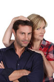 Studio portrait of an affectionate couple in their thirties — Stock Photo