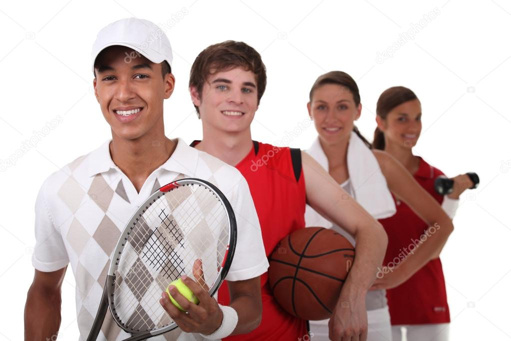 Four teenagers dressed for different sports — Stock Photo #14713741
