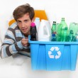 Stock Photo: Young mholding recycling bin