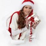 Festive woman holding gift — Stock Photo