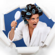 Angry woman with hair rollers and brush — Stock Photo #14721637