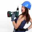 Woman with a power drill — Stock Photo #14722535