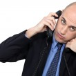 Businessman using two phones — Stock Photo #14724247