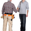 Construction worker and his trainee shaking hands. — Stock Photo #14726345