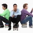 Stock Photo: Goup of bored young men