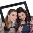 Two friends in a frame. — Stock Photo