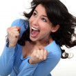 Stock Photo: An ecstatic brunette.