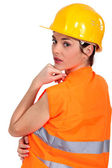 Tradeswoman wearing a hart hat and an orange vest — Stock Photo