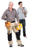 Teenager stood with woodworker — Stockfoto