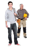 Carpenter stood with young male trainee — Stock Photo