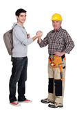Carpenter welcoming his trainee — Stock Photo