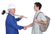 Tradesman meeting new apprentice — Stok fotoğraf