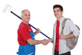 Painter and young man shaking hands — Stock Photo