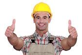 Tradesman giving two thumb — Stock Photo