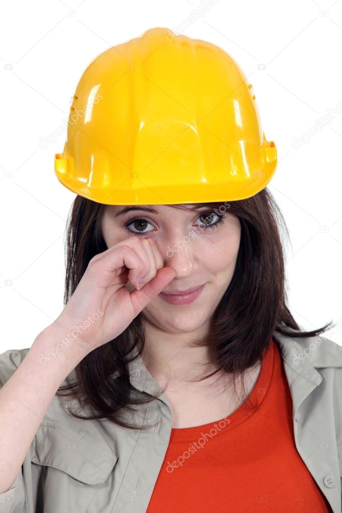 Cute young female apprentice wiping tears  Stock Photo #14725791