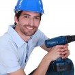 Happy laborer with power drill — Stock Photo #14730331