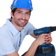 Happy laborer with power drill — Stock Photo
