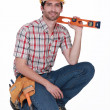 Happy carpenter holding ruler — Stock Photo