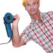 Man holding angle grinder in one hand — Stock Photo #14730525