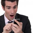Shocked businessman reading text message — Stock Photo #14731639