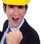 Man with helmet jubilant — Stock Photo #14732111
