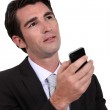 Man thinking before replying to text message — Stock Photo #14732231