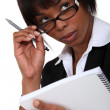 Afro-American businesswoman holding a notepad — Stock Photo