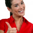 A businesswoman giving the thumb up. — Stock Photo #14734491