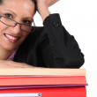 Woman in glasses with a stack of files — Stock Photo