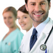 Stock Photo: Doctor and two nurses