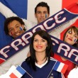 Stock Photo: Two French couples ready to support their national team