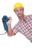 Man holding angle grinder in one hand — Stock Photo