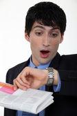 Man panicking looking at his watch — Stock Photo