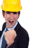 Man with helmet jubilant — Stock Photo