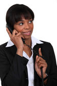 Black businesswoman hopeful of exciting news — Stock Photo